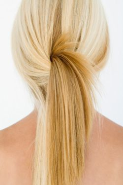 woman with blond hair in stylish ponytail